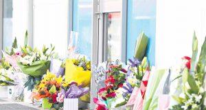Flowers were left outside Mr Randall's Kelmscott office yesterday. Photograph — Matt Devlin.