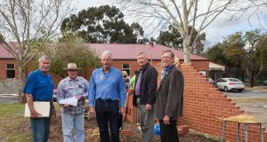 Kenwick rotary club president Ron Mildenhall, project coordinator Steve Weychan, Amaroo care services property and assets manager John Hansen, Gosnells men's shed chairman Geoff Wiltshire and Gosnells RSL president Stuart Holmes joined forces to help build a commemorative wall, which was still under construction. Photograph — Matt Devlin.