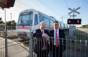 Member for Cannington Bill Johnston and shadow treasurer Ben Wyatt at the Wharf Street level crossing on Monday. Photograph — Matt Devlin.