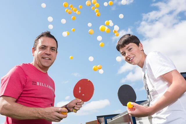 Ping pong-a-thon organiser Martin Dodge and participant Tiger Ross will be playing table tennis this weekend to raise funds to help stop international human trafficking. Photograph — Matt Devlin.