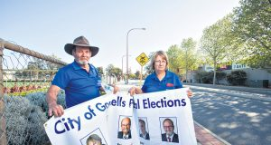 City of Gosnells mayor Dave Griffiths and his wife and campaign manager Jan were forced to replace about $1000 worth of signage after it was tampered with last week. Photograph — Matt Devlin.