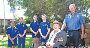Gosnells primary school students Kunal Panchal, Thaw Maung, Chloe La Roche and Olivia Wilson met with WWII veteran Alf Jenaway and Kenwick rotary club project coordinator Steve Weychan. Photograph — Matt Devlin.