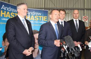 Finance minister Mathias Cormann, Prime Minister Tony Abbott, Canning by-election candidate Andrew Hastie and WA Transport Minister Dean Nalder at a joint announcement to fund the Armadale road duplication at Beaver Tree Services warehouse in Kelmscott on Saturday. Photograph - Robyn Molloy.