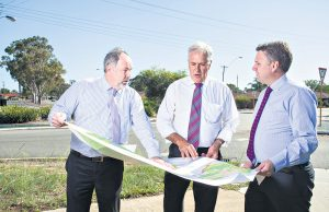 Armadale chief executive Ray Tame, Member for Canning Don Randall and assistant minister for infrastructure and regional development Jamie Briggs discussing the $1.5 million of black spot projects announced for the City of Armadale. Photograph — Matt Devlin.