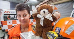 Armadale SES deputy manager Connie Eikelboom appreciates the donation of bears. Photograph — Matt Devlin.