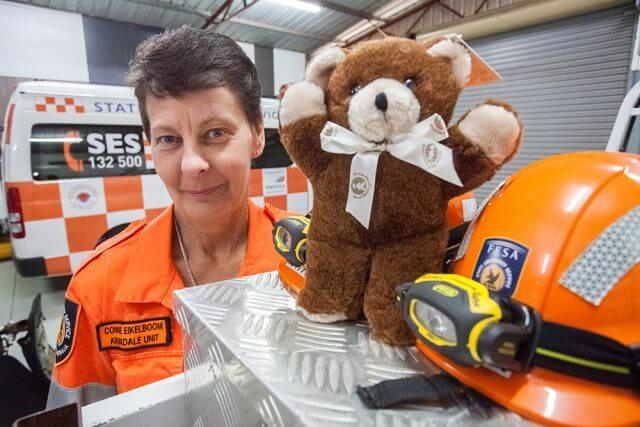 Armadale SES deputy manager Connie Eikelboom appreciates the donation of bears. Photograph — Matt Devlin.