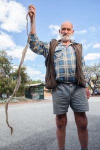 Mr Mann with the snakeskin he found at his son's Byford home. Photograph — Matt Devlin