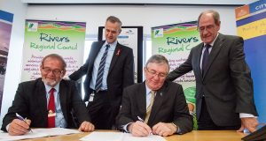 Local Government Minister Tony Simpson and Rivers Regional council chief executive Alex Sheridan witness City of Gosnells mayor Dave Griffiths and Rivers Regional council chairman Ron Hoffman signing the contracts for the alternative waste treatment facility. Photograph — Matt Devlin.