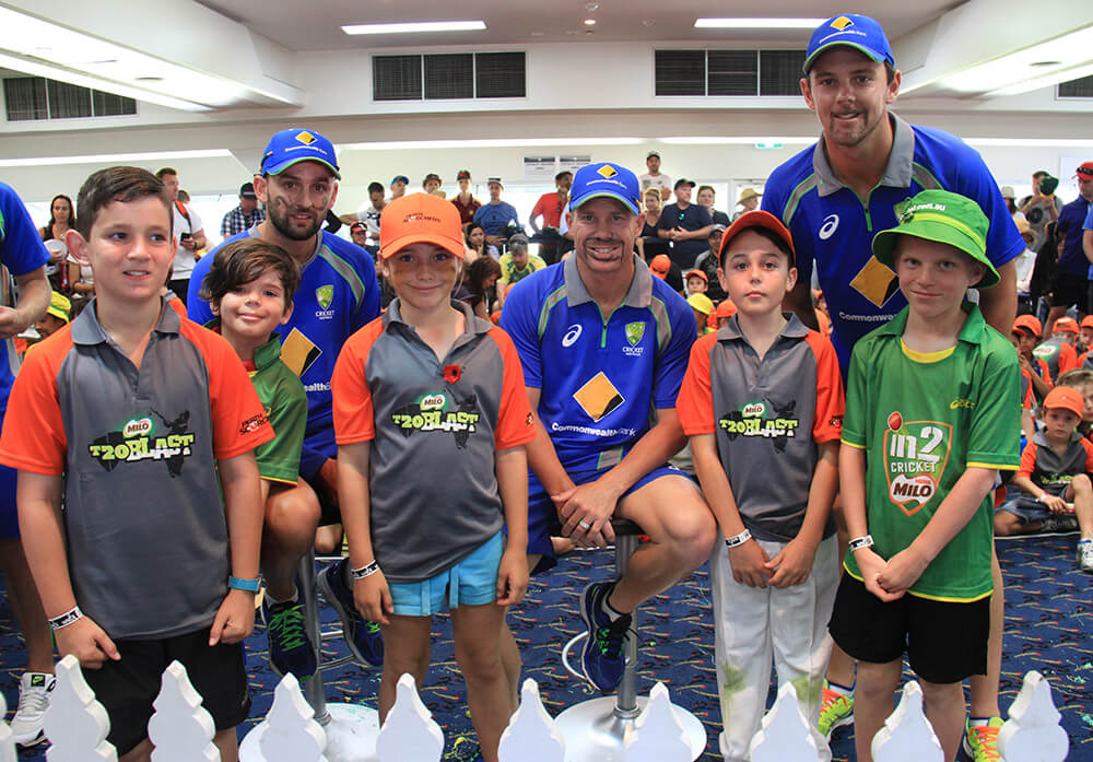 Lyon, Warner and Hazlewood sport their moustaches with juniors from Cannington, Gosnells, Armadale and Thornlie. Photograph — Robyn Molloy.