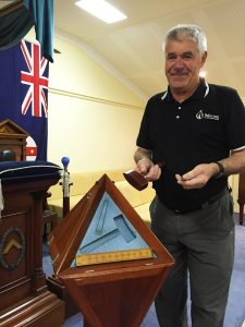 Chuck Frame with the symbolic tools of the Freemasons. Photograph — Robyn Molloy.
