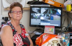 Serpentine Jarrahdale RSL op shop volunteer Judy Petrie with CCTV footage showing the outside of the shop's premises. Photograph — Matt Devlin.