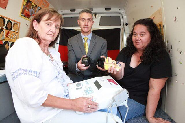 Ear bus ear screeners Jane Matthews and Tania Harris and Member for Armadale Tony Buti are worried ear health in indigenous children will be compromised. Photograph — Matt Devlin.