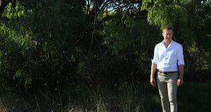 Environment Minister Albert Jacob at the Wharf Street Wetland. Photograph — Hamish Hastie.