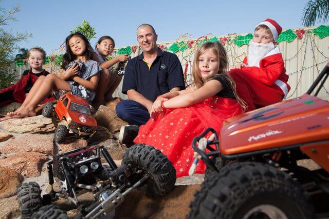 Clare Campbell, Ruby, Jade and Darren Duncan, Sarah Upton and Jamie Campbell with the RC rock crawlers. Photograph — Matt Devlin.