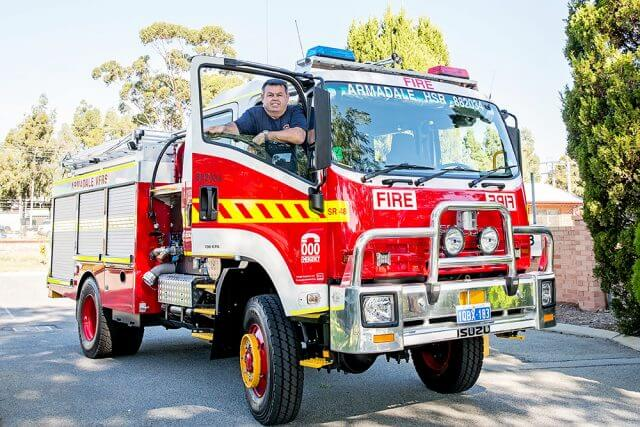 Armadale Volunteer Fire and Rescue Service captain Andrew Clift in the service's new hazmat structural rescue truck. Mr Clift will be honoured for his 30 years of service on April 10. Photograph — Kelly Pilgrim-Byrne.