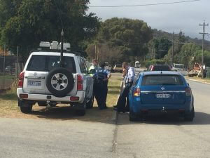 Police gather at the scene. Photograph - Amy Blom.