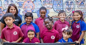Parkwood Intensive English Centre deputy principal Letchme Paul with students who will be involved in the multicultural festival celebrations. Photograph — Kelly Pilgrim-Byrne.