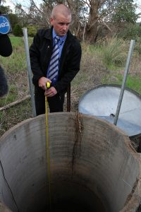 Senior constable Tom Grieve from Armadale Detective at the well where the 19-year-old was found. Photograph – Matt Devlin.