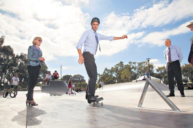 Youth Minister Tony Simpson tries out the skate plaza in Beckenham on Wednesday afternoon while City of Gosnells director of infrastructure Dave Harris watches on in amazement at Mr Simpson's skills. Photograph — Matt Devlin.