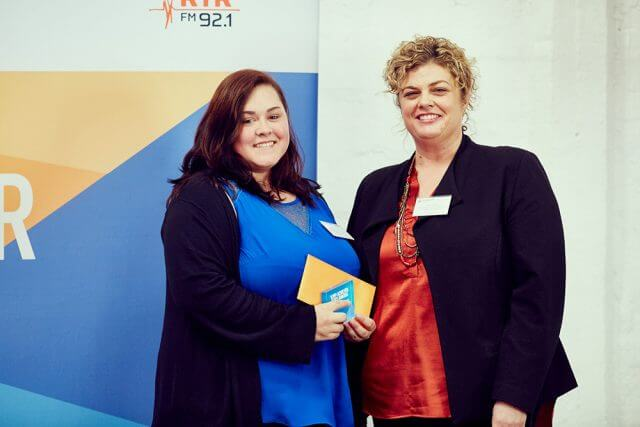Laura Smith, 18, accepting her registered training achiever award from Department for Child Protection and Family Support's director general Emma White.