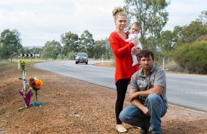 Adam, Lotti and Emilia Fairey at the S-bend outside their property, which has been the scene of three major crashes in six months. Photograph — Matt Devlin.
