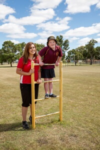 Maddington Education Support Centre teacher Sarah Priestley and Abbie Gliddon, 9, are promoting the world's biggest human blood drop event. Photograph - Kelly Pilgrim-Byrne.